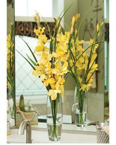 Raq - maybe adding purple flowers to something like this?  Flowers Store: Yellow Silk Gladiolus & Grass Centerpiece