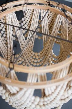 DIY Bead Chandelier - The House That Lars Built - Kronleuchter Handmade Home Decor, Diy Home Decor, Pottery Barn Hacks, Diy Luminaire, Wood Bead Chandelier, Chandeliers, How To Make A Chandelier, Handmade Chandelier, Pendant Lamps