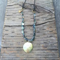 OM pendant necklace/abalone & fossil beads on dark by SirenaHome