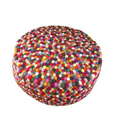 Multicolored Felt Ball Ottoman Pouf. This is a stunning designer multicolored felt ball ottoman pouf which is hand made in Nepal by women under the Fair Trade act.  Each felt ball is hand dyed with individually chosen colors, then hand sewn not glued creating a wonderful soft natural fiber floor mat/rug which is soft to lay on and soft under foot.
