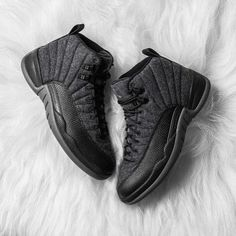 The Air Jordan 12 with a revamped wool composition look to welcome the Fall season as its set to make its official debut this weekend.  Built with more functionality the sneaker has also been elevated with premium flair and stylish sensibilities. The defining woolen upper is reinforced with tonal textured leather on the forefoot to retain its traditional build while accents of white adorn the tongue with respective branding to cap off its subdued makeup. _ Available at kickbackzny.com.