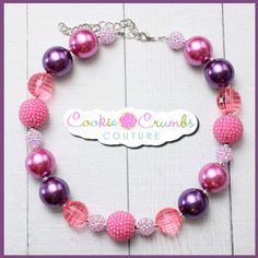 """This chunky beaded necklaces is a must-have piece for your daughter's collection. Who doesn't love the sweet colors of purple berries. With bright coordinating shades of purples, it is sure to match many outfits in your little one's closet! Perfect for every season.  Handcrafted from quality items, our necklaces are not mass produced and are made to last! All of our necklaces are made to be approx. 16"""" with 4"""" in chain so that it can grow with your child and fit many ages."""