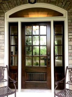 Beautiful wood front door with arched window