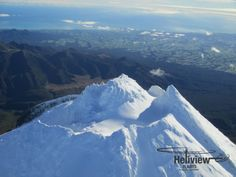 A close-up of the snowy peak of Mt Taranaki. Sharks Tooth on the right, the summit in the centre, looking down at the Ahukawakawa Wetland and Pouakai Range. New Zealand North, Sharks, Close Up, Mount Everest, Tooth, Centre, Range, Island, Mountains