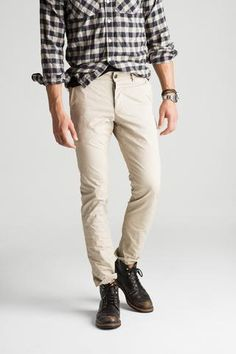 """Made with a smart sense of contemporary tailoring, this pant combines a classic Khaki hue with a stylish skinny fit. Finished with custom hardware and washes, this Khaki pant is a standard for the modern man.  32"""" Inseam 13.5"""" Leg Opening 8oz Twill 100% Cotton Hand-Crafted in the USA"""