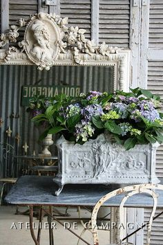 I can get plaster paris pieces to make my frames!  I love that frame's centerpiece, plus the plant box! - Love, Grace