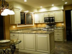 white glazed kitchen cabinets pictures | After. Glazed white cabinets, granite countertops, and new lighting ...