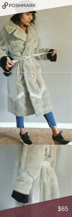 """Vintage Faux Fur Coat Vintage Faux Fur Coat in light grey.  Beautiful piece to wear for any occasion on a cold day. Had so much fun styling this one! Gently worn with minimal stain along the hem. Color distressing on the faux leather piece. Missing 2 buttons along the left lapel.  - Faux fur, vintage, off brand - Size 8 - length: 41"""", waist 27"""" (approximate) -Belted Jackets & Coats Trench Coats"""