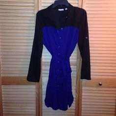 Slip dress New York and company slip shirt dress  black and blue perfect for office or to go out with some black pumps . Size medium worn only once New York & Company Dresses Long Sleeve