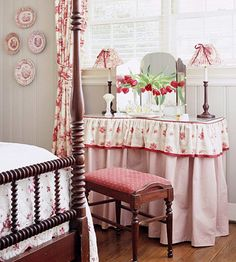 pretty reds, great mix of patterns. I love the bed too. I had one of these dressing tables as a girl. Sure felt special.