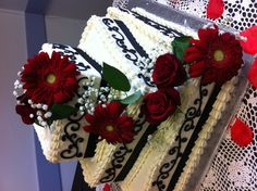 Simple red black and white wedding cake.