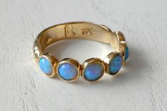 Hey, I found this really awesome Etsy listing at https://www.etsy.com/listing/184827881/blue-opal-ring-14k-yellow-gold-plated