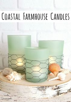 Is Coastal Farmhouse a style of home decor? If not, IT SHOULD BE! You can combine the best of both worlds with this upcycling idea for glass candle holders that end up looking like the beach theme decor or coastal home decor of your dreams. Get all the DIY details at www.sadieseasongoods.com . #coastal #beachdecor #beachcottage #seaglass #coastaldecor #beachhouse #upcycled #spraypaintforglass #coastalhomedecor