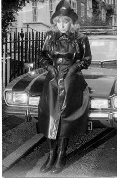 A woman in an SBR mackintosh on the bonnet of a 1970 Ford Capri. Black Raincoat, Pvc Raincoat, Plastic Raincoat, Hooded Raincoat, Black Mac, Rain Fashion, Rubber Raincoats, Walking In The Rain, Rain Gear
