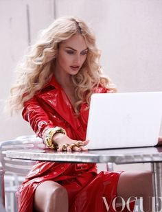 Candice Swanepoel in a cherry red trench for Vogue Mexico.