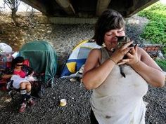 Poverty in America - Living under bridges! Sharon and her kitten live with homeless friends in Hawaii.