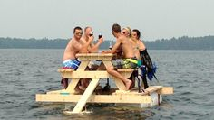 Floating picnic table is integrated with electric motor and wooden table that sails above water like a party barge.