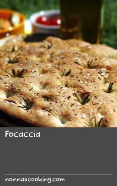 Focaccia |      This flat bread dates back to Ancient Rome and was originally cooked in the ashes of the fire – 'focus' means hearth or fire in Latin! Before baking, the dough is sprinkled with a topping, such as coarse salt and herbs, and you make little dimples in the surface with your finger. We cooked this by the side of a canal in Venice – very romantic! Bread Dough Recipe, Focaccia Recipe, Coarse Salt, Flat Bread, Ancient Rome, Dimples, Hearth, Dates, Venice