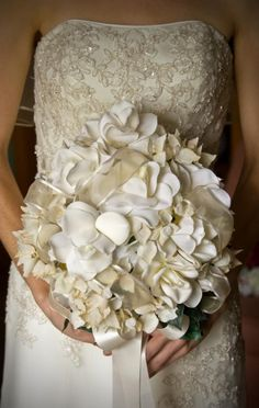 Neutral Bouquets  Brides who wear off-white gowns can create a bouquet that matches their dress color and style. Cream, beige, champagne and ivory blooms are readily available in a variety of flowers. Bring a swatch of the dress to your florist appointment if you want to match your gown color.