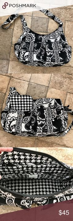 """Vera Bradley Midnight Paisley Cargo Sling EUC Gorgeous and very gently used Vera Bradley Cargo Sling Crossbody in Midnight Paisley. Retired bag and print! This roomy bag is perfect for work, travel, as a diaper bag & everyday purse. Black & white pattern coordinates w/ everything! Exterior features 2 exterior gusseted cargo pockets, a full-width zippered compartment on the back & a slip pocket on each end. Interior features 3 slip pockets. Zip closure. Dimensions 14"""" w x 12 ¾"""" h x 6"""" d w…"""