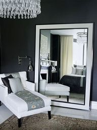 A nice wide mirror could work nicely with perpendicular chaise idea.