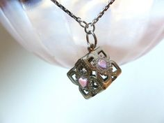 Hey, I found this really awesome Etsy listing at http://www.etsy.com/listing/110527939/portal-2-companion-cube-inspired-heart