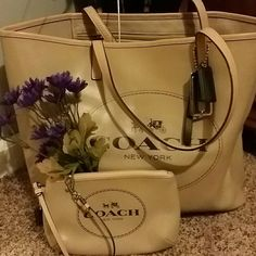 Tan with hunter green writing coach tote Comes with matching wristlet.  Good condition has a few pen marks on the inside as shown in pic 4. coach Bags Totes