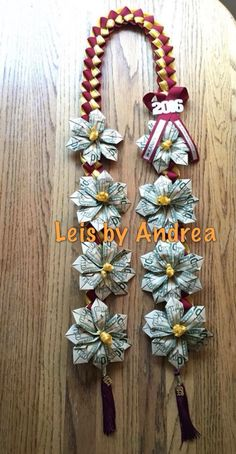 Personalized graduation ribbon and money leis. School colors, name of school… Diy Graduation Gifts, Graduation Leis, Money Lei, Money Origami, Creative Money Gifts, Money Flowers, Employee Appreciation Gifts, Crafty Craft, Crafting