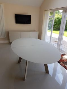 Moon Oval Glass Table In Matt Glass And Matt Lacquered Legs. Table Size:  180cm