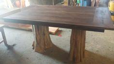 Black walnut on red cedar legs. Stump kitchen table.see us on fb at Modern Frontier Log furniture