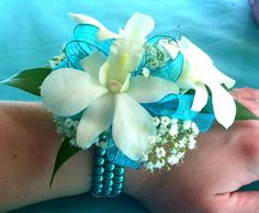 We love wrist flowers but how about this as an ankle flower. A matching set wrist and ankle is awesome! Easy to make and customize. For flower girls, brides maids, mother's flowers. OR tickle your fancy with a unique identification wristbands for meetings, conferences, groups, use your imagination. Pool parties, bff, wedding and travel gifts.   www.destinationweddings.travel #allweddingsallowed
