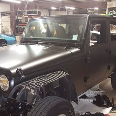 Satin black jeep wrap happening today.