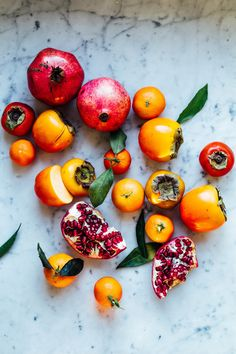 CLEMENTINE, PERSIMMON & POMEGRANATE SALAD  'A FRESH FRUIT SALAD FOR THE NEW YEAR'  (Serve 4)   Salad:      * 2 pomegranates     * 5-6 clementines     * 4 persimmons     * 3-4 tbsp yellow raisins     * 4-5 tbsp almonds laminates     * Dried flowers (calendula, rose...)   Dressing: