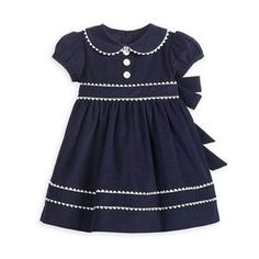 Adorable Navy corduroy dress with white Ric Rac pipping at edges. Puff sleeve and Peter Pan collar. The Sloane dress also comes in Apple Green. Baby Dress Design, Baby Girl Dress Patterns, Baby Frocks Designs, Kids Frocks Design, Kids Dress Wear, Toddler Girl Dresses, Toddler Fashion, Kids Fashion, Fashion Outfits