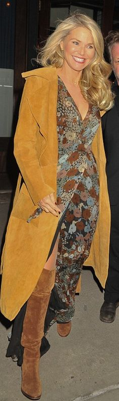 Who made Christie Brinkley's brown floral wrap maxi dress and tan suede coat?
