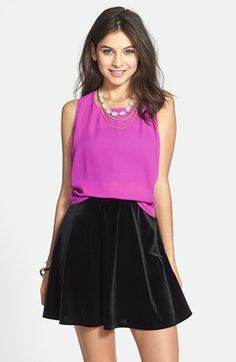 Lily White Crushed Velveteen Skater Skirt (Juniors) available at #Nordstrom. The skater cut skirt is trending right now in skirts and dresses. Paired perfectly, the black velvet contrasts the neon top. Alexandra W.