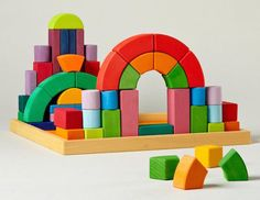 The Colorful Grimms Romanesque Building set is an amazing heirloom wooden block set if you want a really special gift for kids