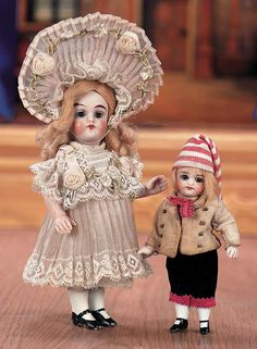 "Two German all-bisque mignonettes with swivel heads, in original costumes for the French market (girl is 5"", boy is 4"") c.1890"