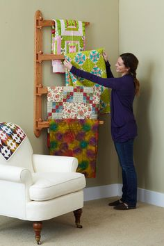 This weekend project saves floor space and puts prized quilts where they're readily seen and easily retrieved. We built ours using red oak for the upright and swinging arms, but yours could easily use whatever wood matches your room furnishings.