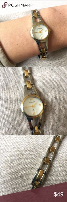 "Gold & Silver Fossil Watch 🔥 + Water resistant up to 100 feet. Needs a new battery.  + Approx. .5"" diameter face. Watch wrist length is approx 5.5"" long!  + Perfect for everyday wear!  + Don't forget to bundle! Check all photos, it has some day to day wear shown 🎉❗️ ⭐️All items are steamed cleaned and shipped within 48 hours of your purchase. ⭐️If you would like any additional photos or have any questions please let me know. ⭐️Sorry, no trades. But will listen to ALL fair offers. Thanks…"