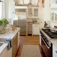 A small but bright kitchen  Laguna Beach Cottage | Choose a Hard-Working Layout | CoastalLiving.com