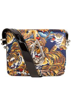 Kenzo Flying Tiger Print Bag  http://style-card.co.uk/id/portfolio/kenzo-flying-tiger-print-bag/  StyleCard iD is a fashion and lifestyle community, celebrating individualism. Each person and brand has their own story and a unique style. Discover and share with iD.