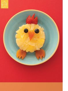 Chicken Snack -   For the body, cut a think, round slice of apple (vertically or horizontally) and remove any core and seeds.  For the feathers, place small pieces of pineapple on top, then add blueberry eyes, a strawberry comb, and a bead and feet of dried apricots.