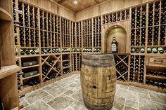 A wine lover's dream!  Custom wine cellar by Toulmin Homes