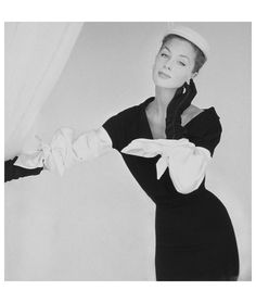 Suzy Parker,wearing black dress and white hat by Hattie Carnegie, with white bowknot satin sleeves by Balenciaga, Vogue, September 15, 1953. Photo John Rawlings, Condé Nast Archive
