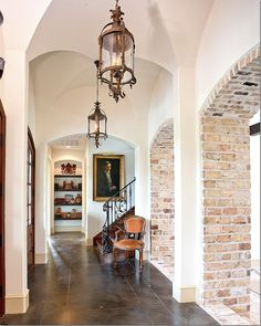 The floors are stained concrete and brick. The couple love exposed brick and chose to put a lot of it inside the house.
