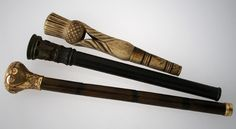 Victorian parasol handles, from top to bottom; carved bone thistle, carved horn and wood, and rolled gold on bamboo