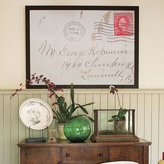 Enlarge an old letter or envelope with handwriting and frame it.