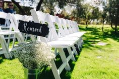 Purchased this sign from www.save-on-crafts.com & did some chalk board pen calligraphy on it to indicate the reserved rows at our wedding. I also got the galvanized tin pot from there too! Wedding location - The Windmill Winery in Florence, AZ http://thewindmillwinery.com/  Photo taken by Buck Deitz Photography - http://www.buckdeitzphotography.com/