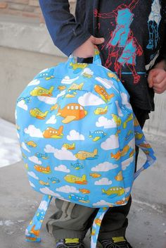 Toddler backpack sewing tutorial -- I would probably add a pocket on the outside, too!